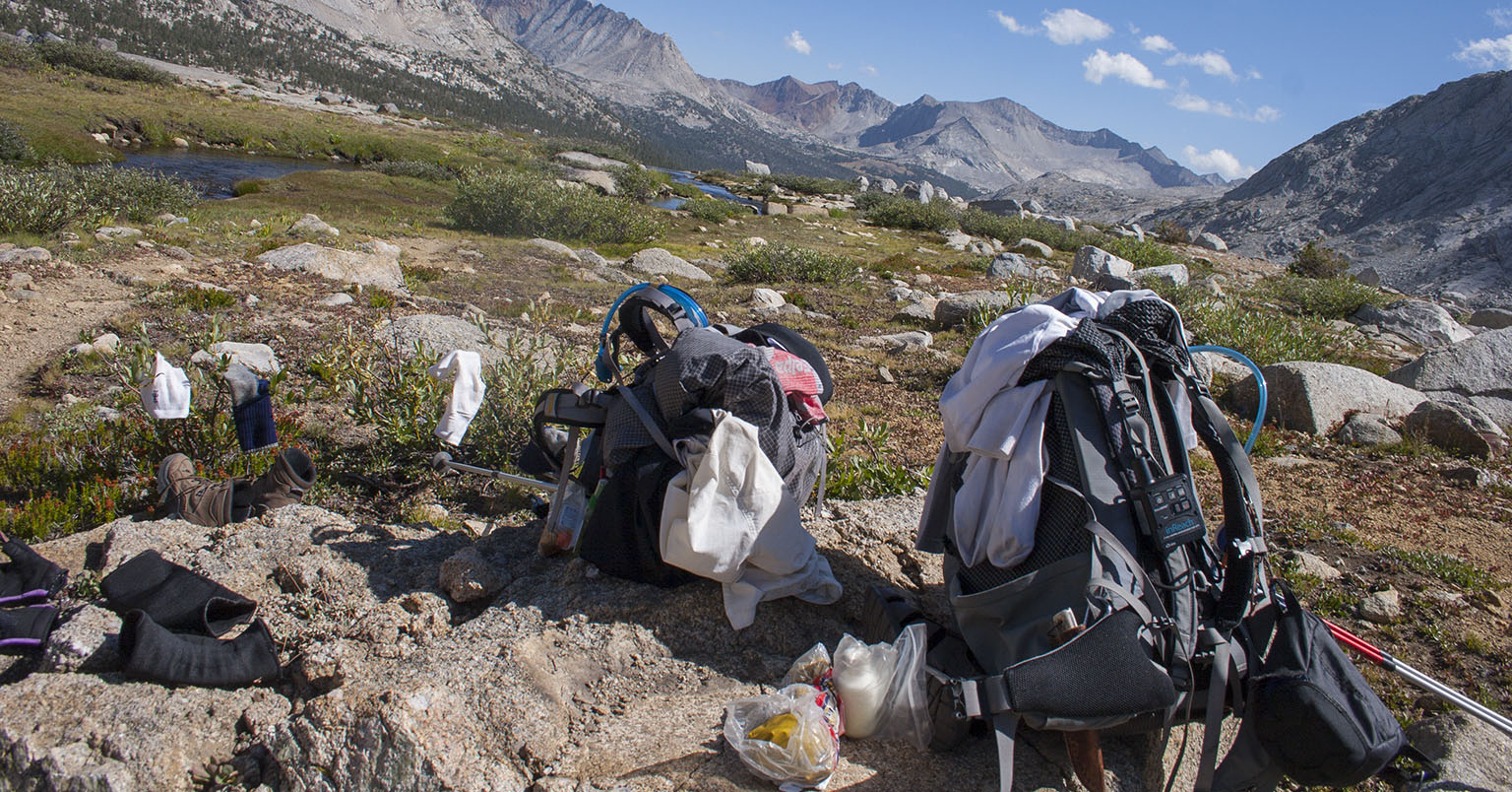 Packs resting in Upper Basin below Mather Pass