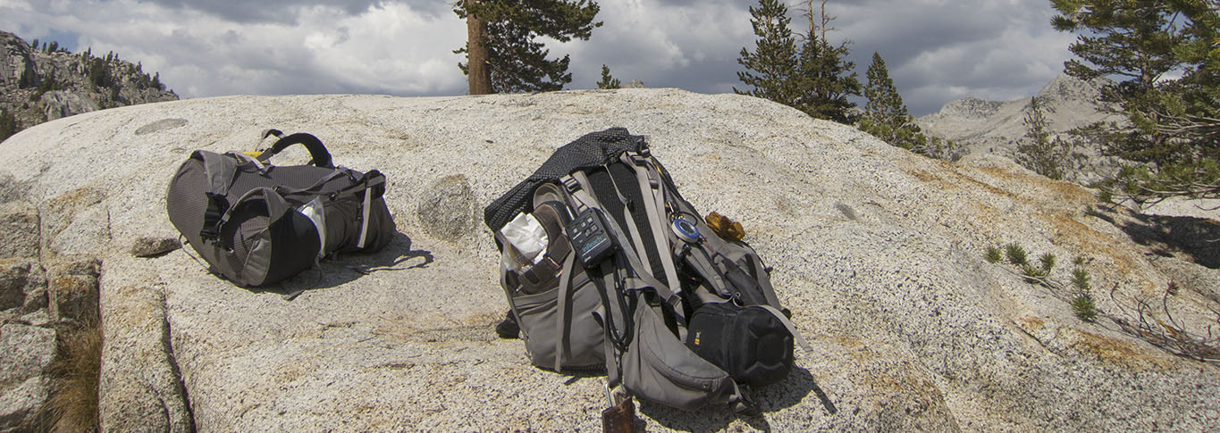 Our packs resting at Granite Lake (on the Two Kings Loop) with the inReach on the strap.