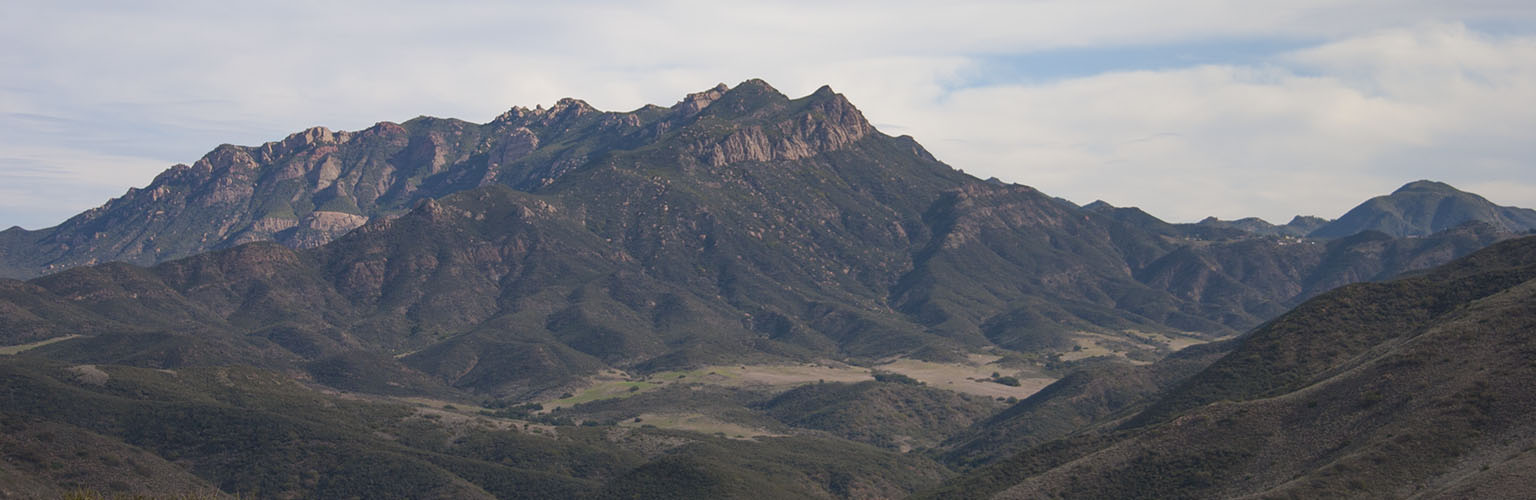 The view of Boney Ridge with Sandstone Peak on top and Serrano Valley below