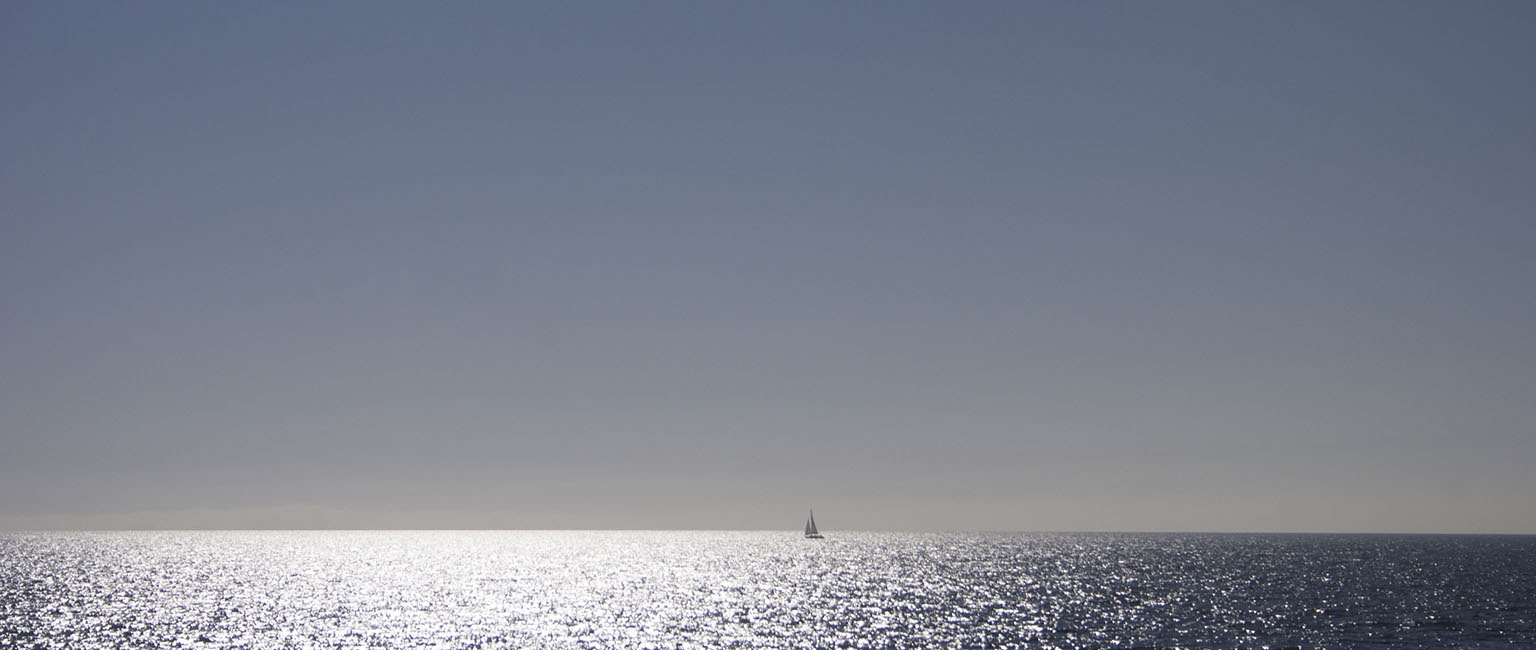 Sailboat in the morning light between Santa Catalina Island and the mainland