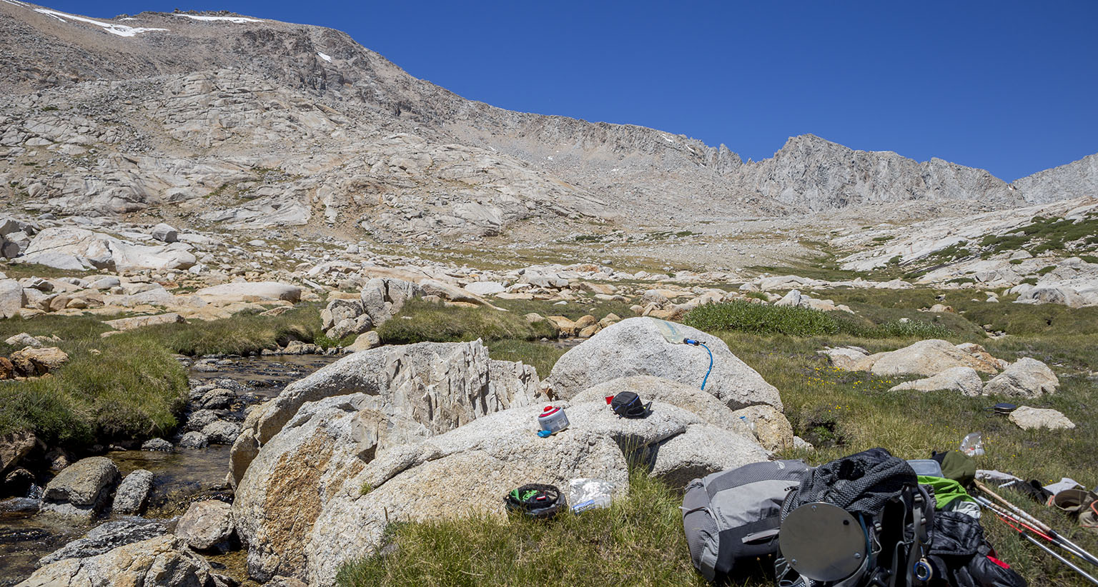 Lunch spot and our messy gear. Forester Pass is the tiny snow spot on the far right in the back