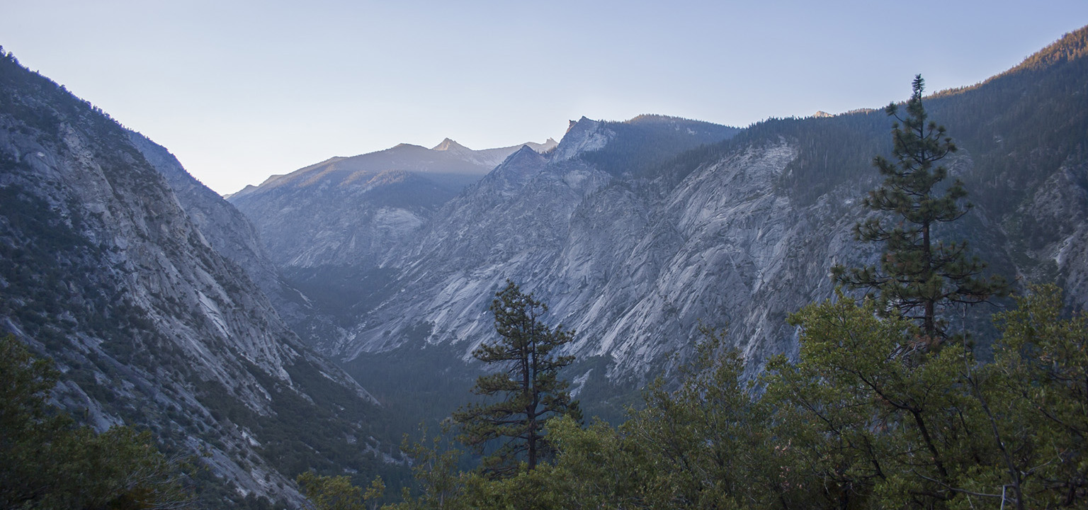 Kings Canyon at dawn, with sunlight hitting the uppermost peaks above Bubbs Creek