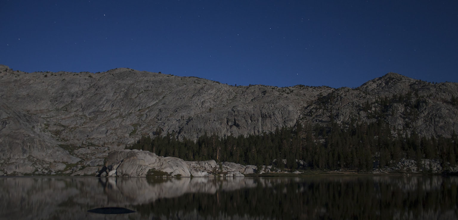 Granite Lake by moonlight - the dark shape in the water is not the back of the Loch Ness monster, it's just a rock