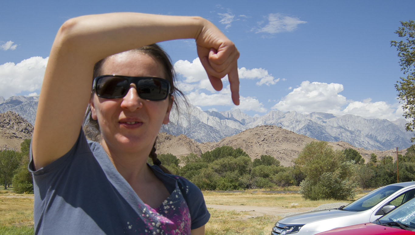Em pointing at Mt. Whitney from the parking lot of the Easter Sierra Interagency Visitor Center in Lone Pine