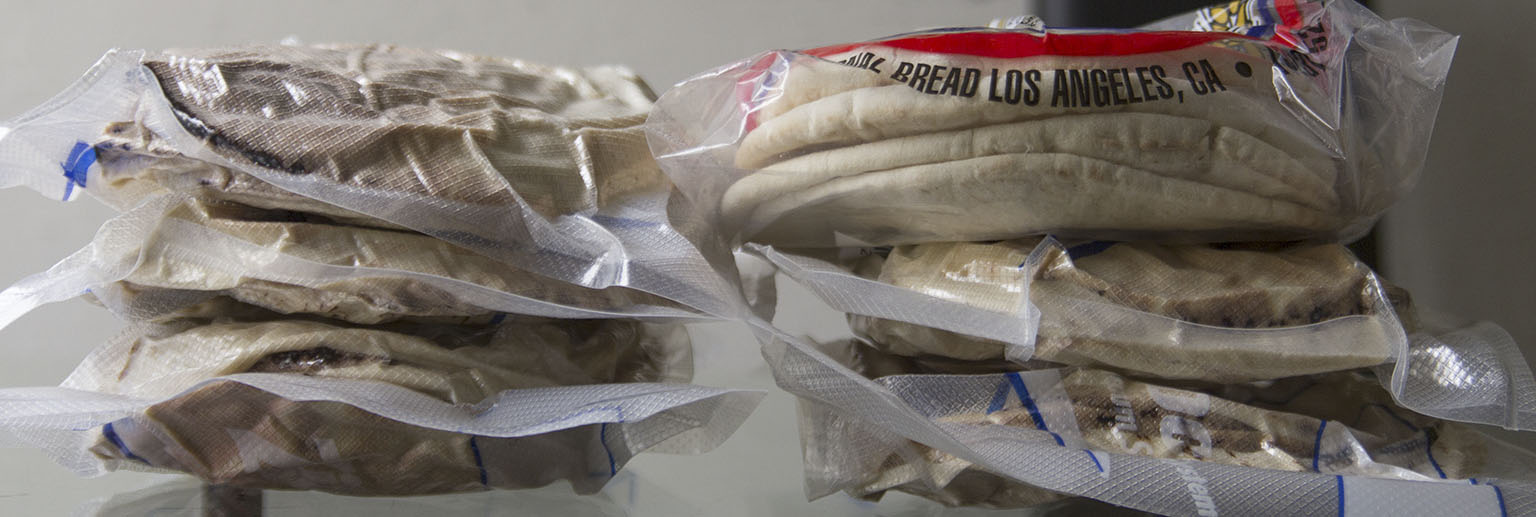 Right top: one bag with 6 normal pita breads. The other five compressed packages contain 48 pitas in total.
